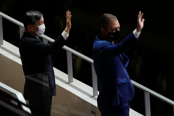 Japan's Emperor Naruhito, left, and Andrew Parsons, president of the International Paralympic Committee, waved during the start of the opening ceremony.