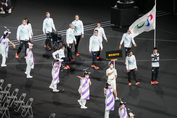 The Refugee Paralympics team leads the Parade of Nations to the Olympic Stadium during the opening ceremony of the Paralympic Games in Tokyo.