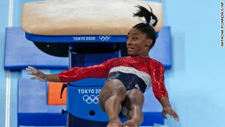 Simone Biles performs on the jump during the women's final in Tokyo