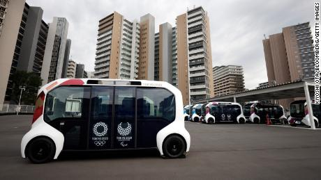Toyota has suspended the use of its electronic vehicles in Olympic Village after one of them collided with a visually impaired athlete while crossing a pedestrian path.