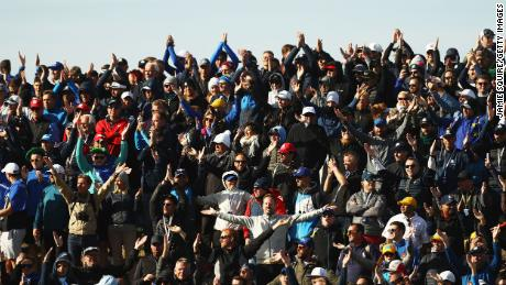 Fans show their support during the four morning football games of the 2018 Ryder Cup.
