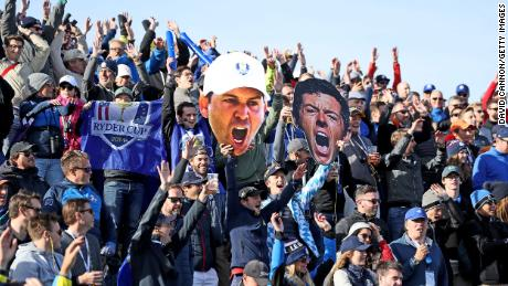 European fans display giant photos of Rory McIlroy and Sergio Garcia during the four morning football games of the 2018 Ryder Cup at Le Golf National.