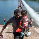 The United States wants to take Haitians home under the Texas Bridge