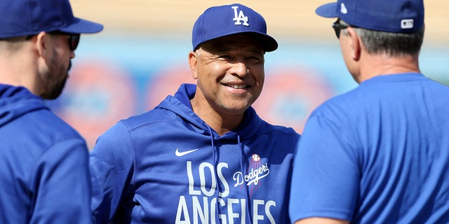 Manager Dave Roberts of the 30th Los Angeles Dodgers looks on before the game between the St. Louis Cardinals and the Los Angeles Dodgers at Dodgers Stadium on Wednesday, October 6, 2021 in Los Angeles, California.