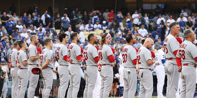 Louis Cardinals line up during pre-game celebrations for the National League Wild Card game between the St. Louis Cardinals and the Los Angeles Dodgers at Dodger Stadium on October 6, 2021 in Los Angeles, California.