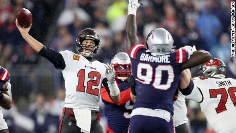Brady throws a pass against the New England Patriots.